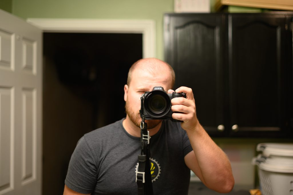 Sawyer Pangborn taking a self-portrait in a mirror